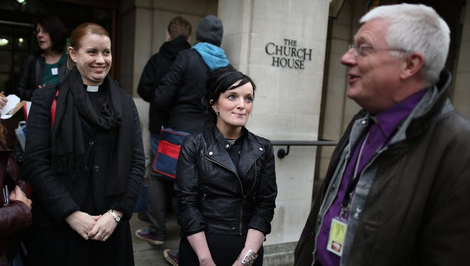 Reverends Nicola Shephard and Sally Hitchiner talk with Peter Broadbent, the bishop of Willesden, outside Church House  in London.