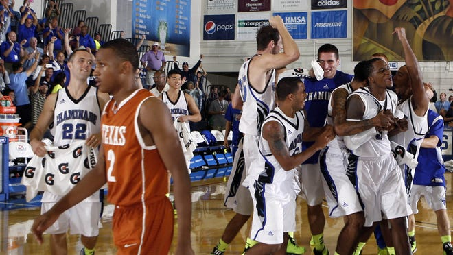 Chaminade players celebrate after defeating Texas in the Maui Invitational.