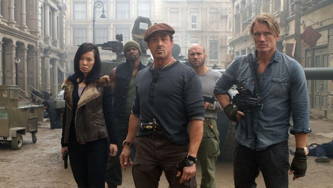 """Sylvester Stallone, Randy Couture and Dolph Lundgren in a scene from """"The Expendables 2."""""""