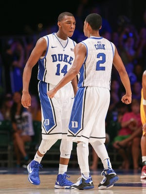 Duke Blue Devils guard Rasheed Sulaimon (14) and guard Quinn Cook react after scoring against the Minnesota Golden Gophers in the second half during the 2012 Battle 4 Atlantis in the Imperial Arena at the Atlantis Resort.