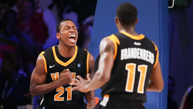 Virginia Commonwealth Rams guard Treveon Graham (21) and guard Rob Brandenberg (11) celebrate after scoring against the Memphis Tigers in the second half during the 2012 Battle 4 Atlantis.