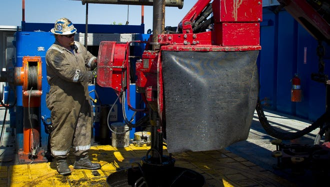 A contract worker drills at a Consol Energy gas drilling rig near the town of Waynesburg, Pa.
