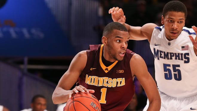 Minnesota Golden Gophers guard Andre Hollins (1) drives to the basket past Memphis Tigers guard Geron Johnson (55) during the 2012 Battle 4 Atlantis in the Imperial Arena at the Atlantis Resort.  Minnesota won 84-75.
