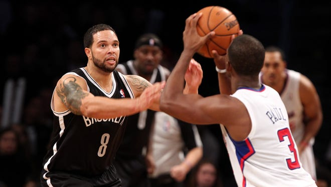 Los Angeles Clippers point guard Chris Paul attempts to shoot over Brooklyn Nets point guard Deron Williams during the second half at the Barclays Center. Nets won 86-76.
