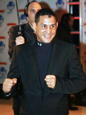 """In this Dec. 14, 2006, file photo, Hector """"Macho"""" Camacho arrives for an event in Miami Beach, Fla."""