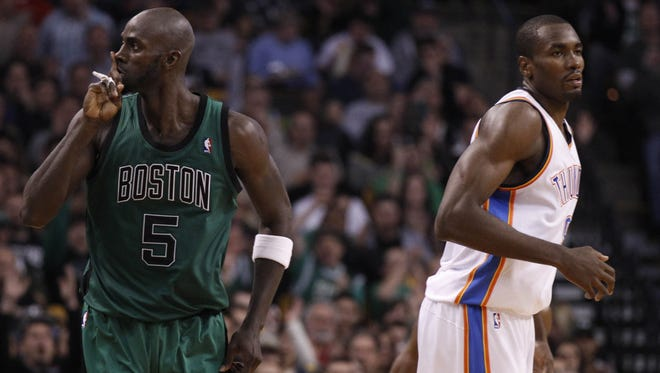 Boston Celtics power forward Kevin Garnett reacts after his three point basket against the Oklahoma City Thunder during the second quarter at the TD Garden.