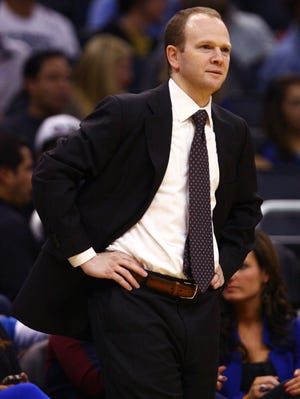 Detroit Pistons head coach Lawrence Frank reacts to a broken play against the Orlando Magic during the first quarter at Amway Center.