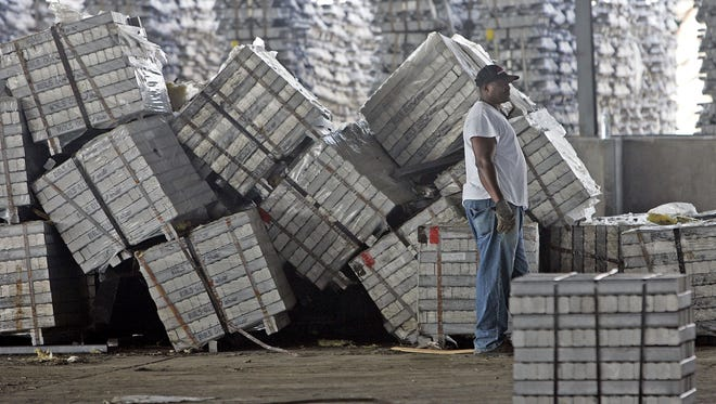 Larry Holloway stands near a load of aluminum at the Port of Gulfport in Mississippi just days after Hurricane Katrina hit in 2005. A half-billion-dollar expansion plan for the port has run into some major obstacles.