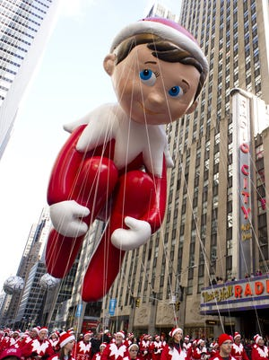 The Elf on the Shelf balloon floats in the Macy's Thanksgiving Day Parade in New York on Nov. 22.
