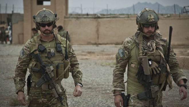 Coalition force members walk through an Afghan National Army compound during a visit with Afghan National Security Force partners in Farah province, Afghanistan.