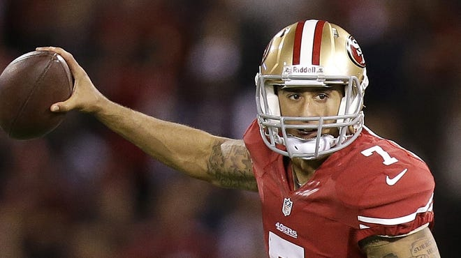 San Francisco 49ers quarterback Colin Kaepernick scrambles from the Chicago Bears during the second half of an NFL football game in San Francisco, Monday, Nov. 19, 2012.