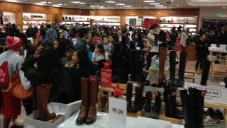 Shoppers crowd the shoe department in search of deals at the Tysons Corner Macy's in McLean, Va.