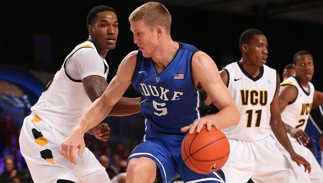 Duke's Mason Plumlee (5) drives against VCU during the 2012 Battle 4 Atlantis in the Imperial Arena at the Atlantis Resort.
