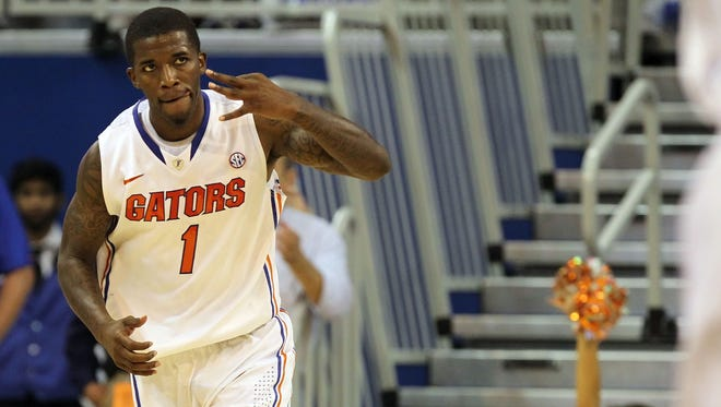 Florida guard Kenny Boynton (1) reacts after he shot a three-pointer during the second half against Central Florida.
