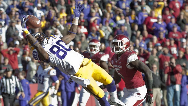 LSU wide receiver Jarvis Landry (80) makes a one-handed  touchdown catch over Arkansas Otha Peters (5) during the first half at Donald W. Reynolds Stadium.