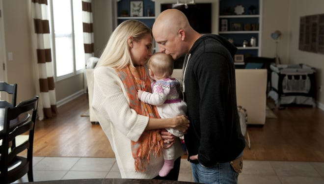 Matt Eastridge and his wife, Meredith, with their new baby daughter, Sloane.
