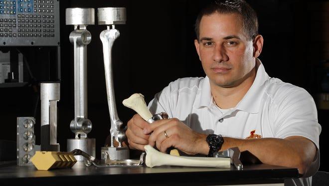 Iowa State University engineering professor Matt Frank works on developing custom bone implants.