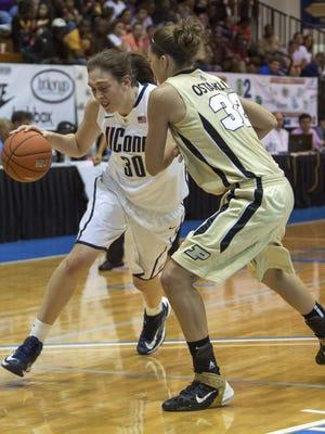 Connecticut forward Breanna Stewart, left, attempts to dribble around Purdue forward Sam Ostarello during an NCAA women's college basketball game in St. Thomas, U.S. Virgin Islands, Saturday, Nov. 24, 2012.