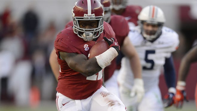 Alabama Crimson Tide running back Eddie Lacy (42) carries up the field against the Auburn Tigers during the second quarter at Bryant Denny Stadium.