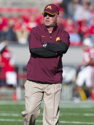 Minnesota Golden Gophers head coach Jerry Kill looks on during warmups prior to the game against the Wisconsin Badgers at Camp Randall Stadium.