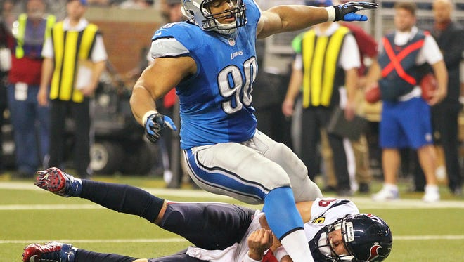 Detroit Lions defensive tackle Ndamukong Suh (90) knocks down Houston Texans quarterback Matt Schaub (8) during the second half of a game on Thanksgiving at Ford Field.
