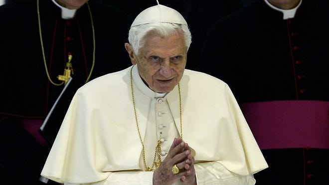 Pope Benedict XVI arrives for his weekly general audience at the Paul VI hall at the Vatican on Wednesday.