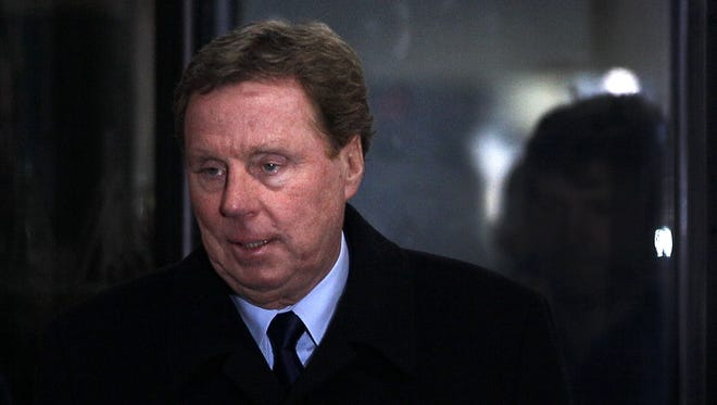 Harry Redknapp has been hired as manager of Queens Park Rangers. Here he's shown in a Feb. 8 file photo leaving  Southwark Crown Court in London, where he was found not guilty of two counts of cheating the public revenue.