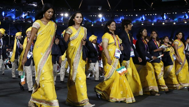 Sania Mirza of India (second from left) parades with fellow athletes during the opening ceremony at the 2012 Summer Olympics on  July 27, 2012, in London.