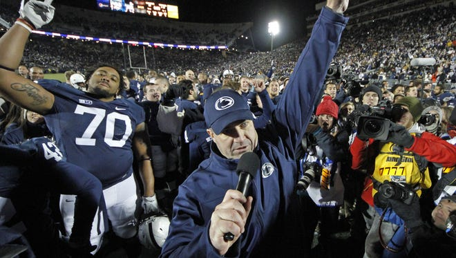 Penn State coach Bill O'Brien celebrates with his team after a 24-21 win over Wisconsin, wrapping up an 8-4 season.