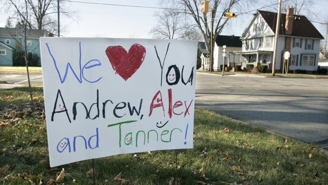 A sign in front of a Morenci, Mich., home in 2010 shows the names of three brothers who have been missing since Thanksgiving weekend of that year.