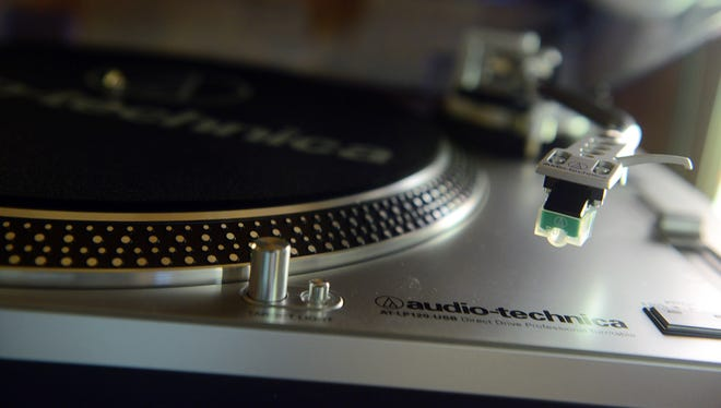 A turntable rests on a shelf at Grimey's New and Preloved Music in Nashville. The store is stocked with vinyl records.