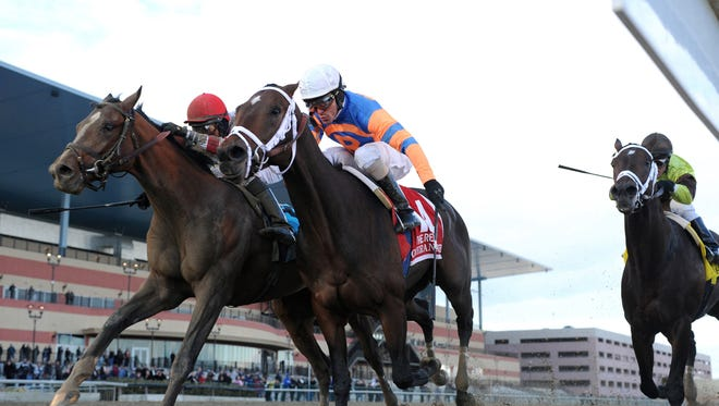 Overanalyze, center, with Ramon Dominguez aboard, captures The G2 Remsen Stakes horse race at Aqueduct in New York on Saturday