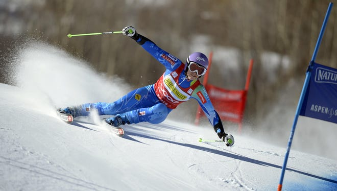 Tina Maze races during the women's giant slalom at the FIS World Cup at Aspen Mountain on Saturday.  She won the race.