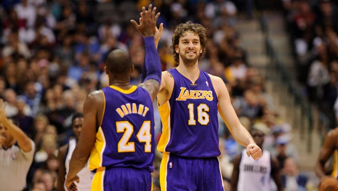Lakers stars Kobe Bryant and Pau Gasol had a lot to be happy about during Saturday's 115-89 win vs. the Mavericks.