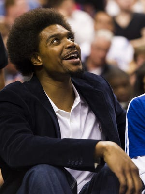 Sixers center Andrew Bynum has watched from the sideline this season.