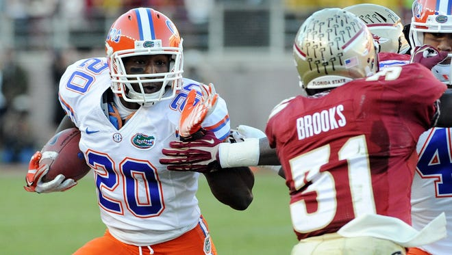 Florida's Omarius Hines (20) runs the ball past Florida State defensive back Terrence Brooks (31) during the Gators' victory against in-state rival Florida State.