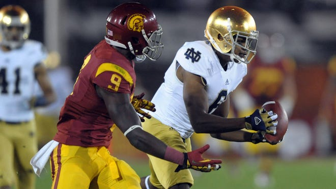Notre Dame cornerback KeiVarae Russell (6) intercepts a pass intended for USC receiver Marqise Lee (9) Saturday in Notre Dame's 22-13 win at the Los Angeles Memorial Coliseum. The victory is expected to propel the Fighting Irish to the BCS National Championship Game.