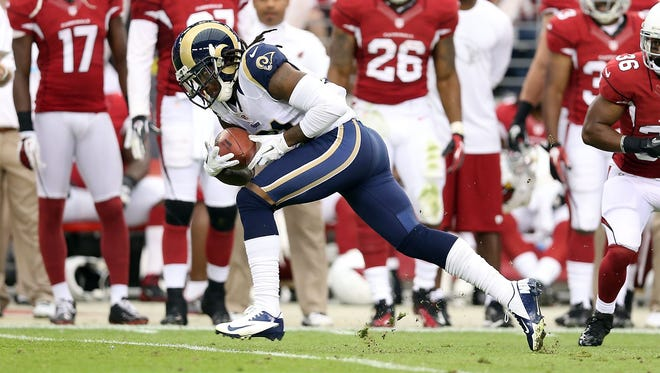 Cornerback Janoris Jenkins of the St. Louis Rams returns a 36-yard touchdown interception past LaRod Stephens-Howling #36 of the Arizona Cardinals during the second quarter of the NFL game at the University of Phoenix Stadium on November 25, 2012 in Glendale, Arizona.