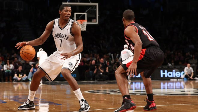 Brooklyn Nets shooting guard Joe Johnson drives around Portland Trail Blazers point guard Ronnie Price during the fourth quarter at Barclays Center.