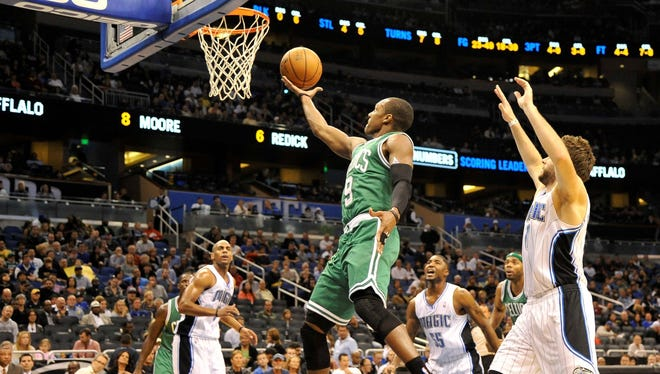 Boston Celtics point guard Rajon Rondo (9) shoots a lay up as Orlando Magic small forward Hedo Turkoglu (15) looks on during  the first half of the game at The Amway Center.