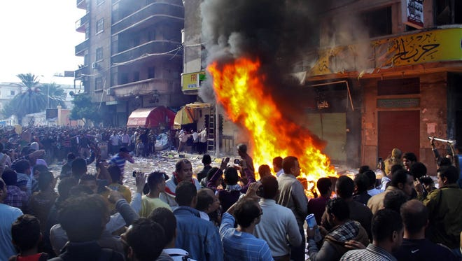Protesters storm an office of Egyptian President Mohammed Morsi's Muslim Brotherhood Freedom and Justice Party and set fires in the Mediterranean port city of Alexandria on Friday.