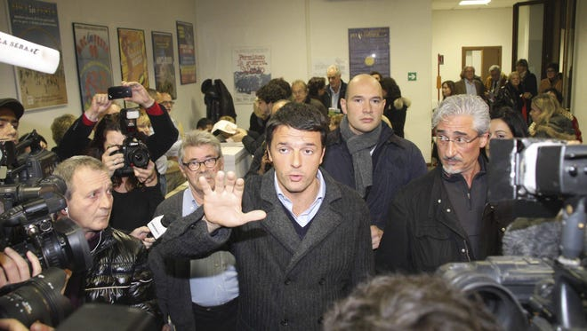 Matteo Renzi, the 37-year-old mayor of Florence, leaves after casting his vote Sunday during a primary for a center-left candidate to run in spring general elections.