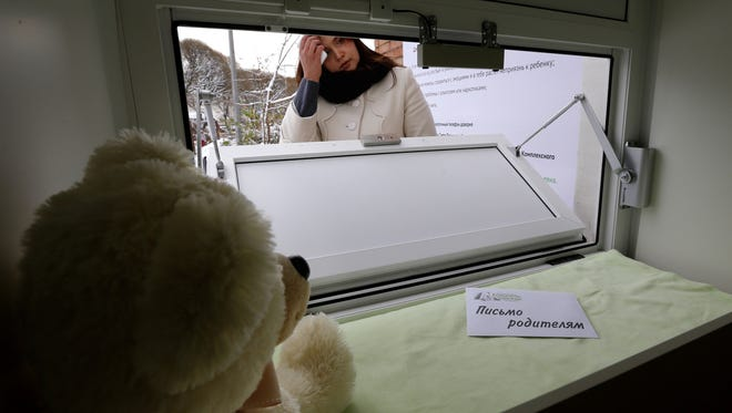 Galina Murzakayeva, a coordinator for a non-governmental organization, opens the baby box in Kirishi, located 60 miles east of St. Petersburg, Russia.