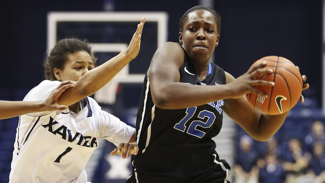 Duke guard Chelsea Gray (12) drives to the basket against Xavier guard Ty O'Neill (1) during the second half of an NCAA college basketball game, Sunday, Nov. 25, 2012, in Cincinnati. Duke won 82-59.