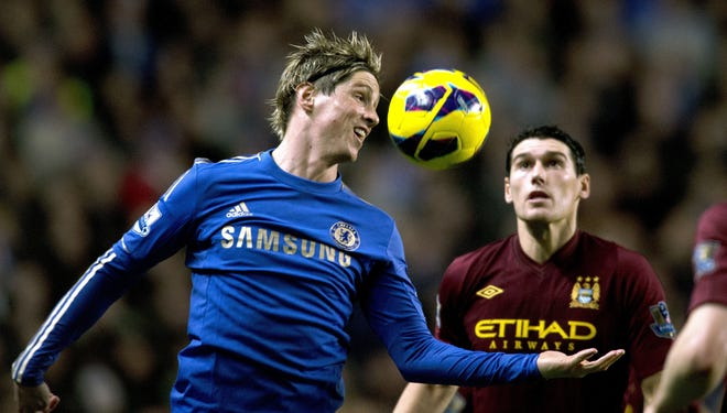Chelsea's Spanish forward Fernando Torres (L) heads the ball as Manchester City's English midfielder Gareth Barry (2nd R) looks on during the English Premier League football match between Chelsea and Manchester City at Stamford Bridge stadium in London on November 25, 2012.