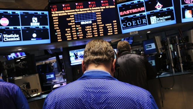 Traders work on the floor of the New York Stock Exchange on Nov. 15, 2012, in New York City.