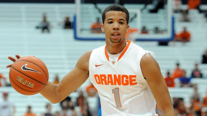 Syracuse Orange guard Michael Carter-Williams (1) brings the ball upcourt during the first half of a game against the Colgate Raiders at the Carrier Dome.