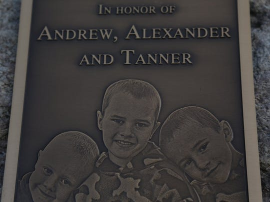 Tanya Zuvers, her family, friends and supporters unveiled a plaque on a rock during a gathering Sunday, Nov. 25, 2012, in Morenci, Mich., to remember her three missing sons, Andrew, Alexander, and Tanner Skelton who were 9, 7 and 5, respectively, when they went missing in November 2010.