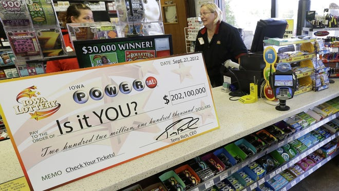 A Powerball promotional check sits on the counter in the Casey's General Store in Bondurant, Iowa, on Sept. 27.