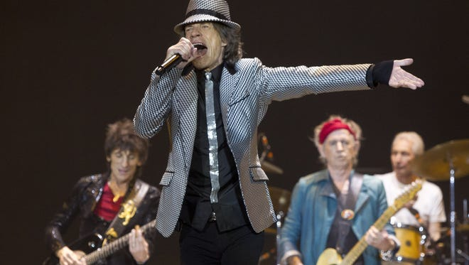 Mick Jagger, front,  Ronnie Wood, left, Keith Richards and Charlie Watts, right, of the Rolling Stones perform at the O2 Arena in London.